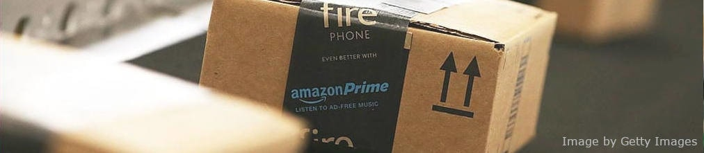 Amazon Prime box with Fire Phone sticker on it moving on conveyor belt of Amazon fulfillment center